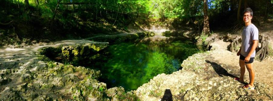 Lafayette Blue Springs State Park - Paul standing by the hole where the cave entry is