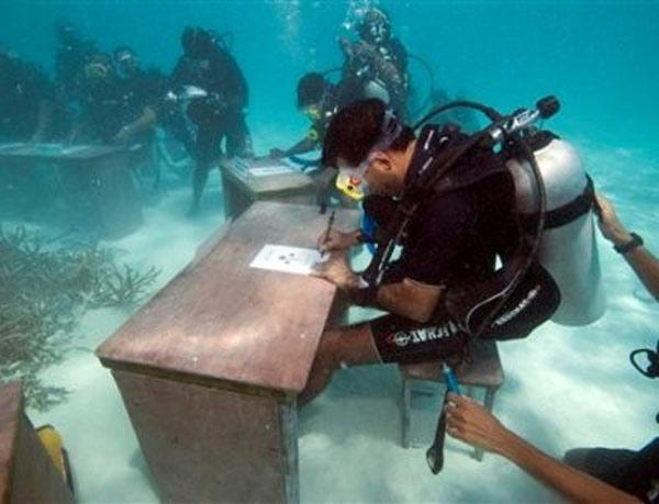 Underwater Meeting of Scuba Divers in the Maldives