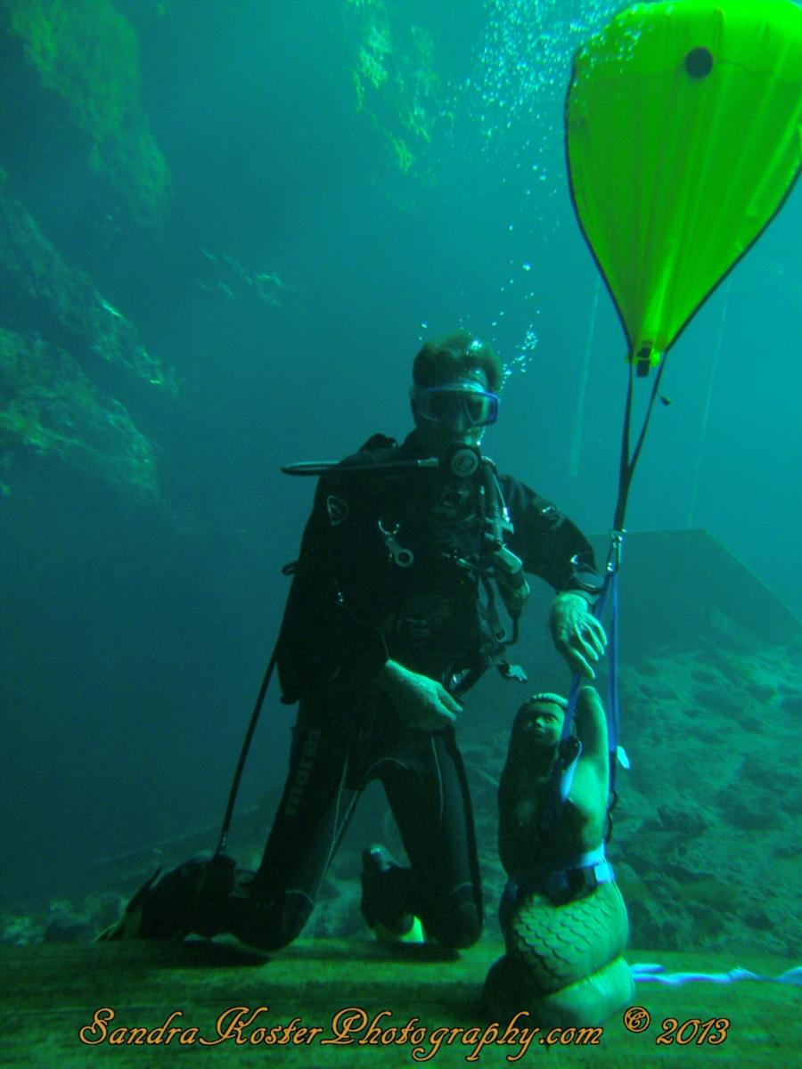 Kurt Huber on platform with new Blue Grotto Mascot