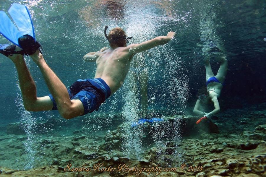 Kids having fun playing in the basin at Ginnie Springs