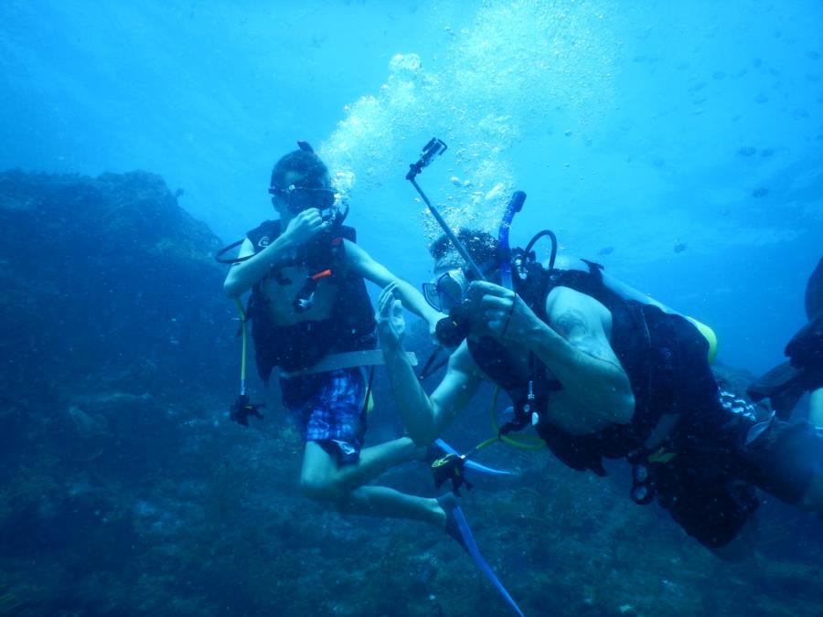 fellow divers blowing bubbles