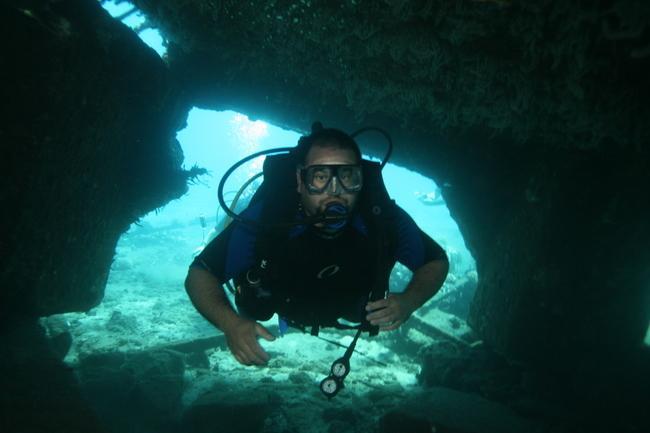 Mala Ramp (Lahaina Pier) - My buddy diving through some ramp wreckage.  Mala Ramp