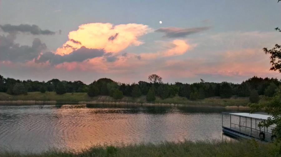 Clear Springs Scuba Park - Moon at Clear Springs Scuba Park during Sunset