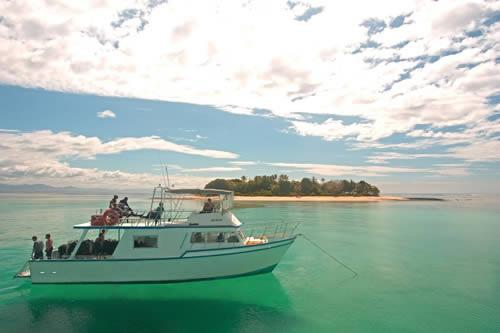 Beqa Lagoon Resort - Boat on crystal clear water