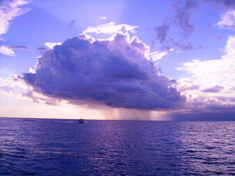 one little storm cloud with a funnel (Cozumel)
