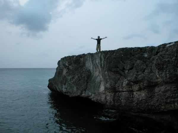 jumping off some cliffs in St. Marteen