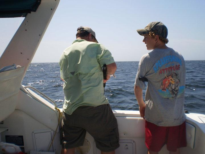 James and I fishing from our boat