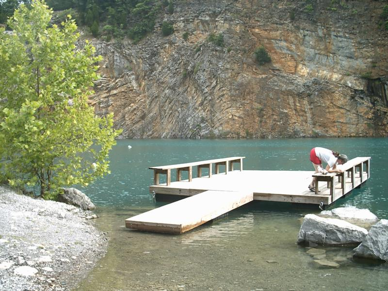 Monica feeds the fish at Philadelphia (Tennessee) Quarry