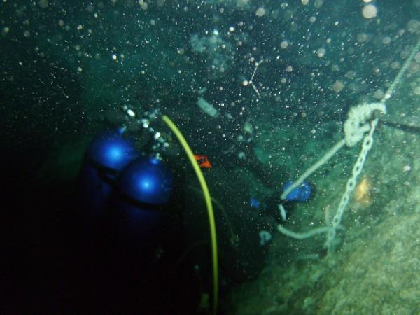 Following the tie down rope to the bottom of Blue Grotto