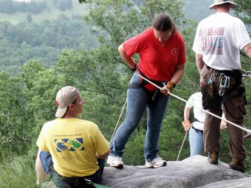 Me (yellow) teaching rappelling, 2010