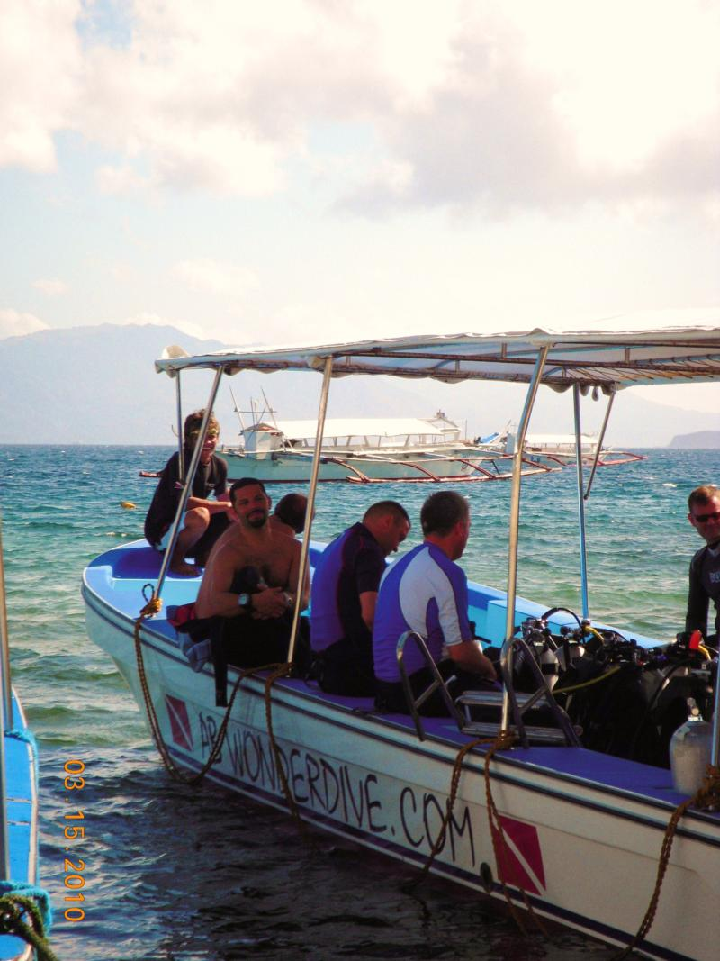 gearing up for a drift dive off the Verde Island wall