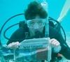 Sue reading the local paper underwater in Bonaire.