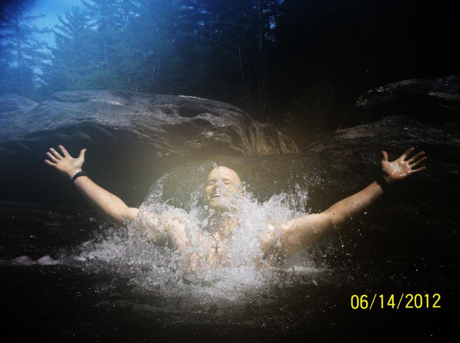 Me under a small waterfall