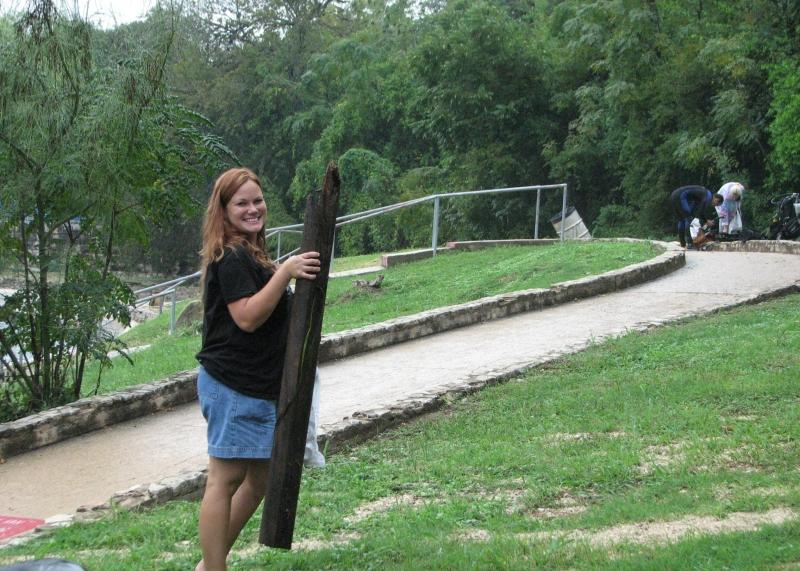 Becky carrying a log during TrashFest 2009