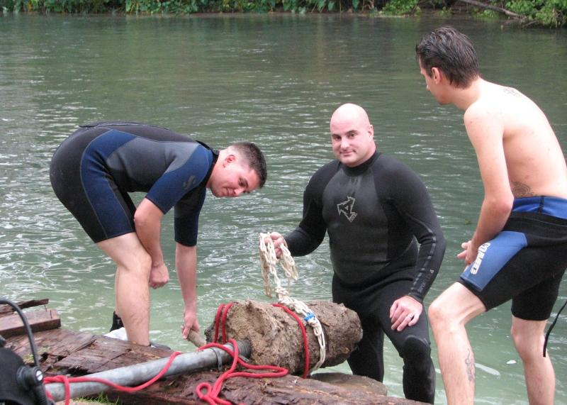 Greg and others lifting a pole out of the river during during TrashFest 2009