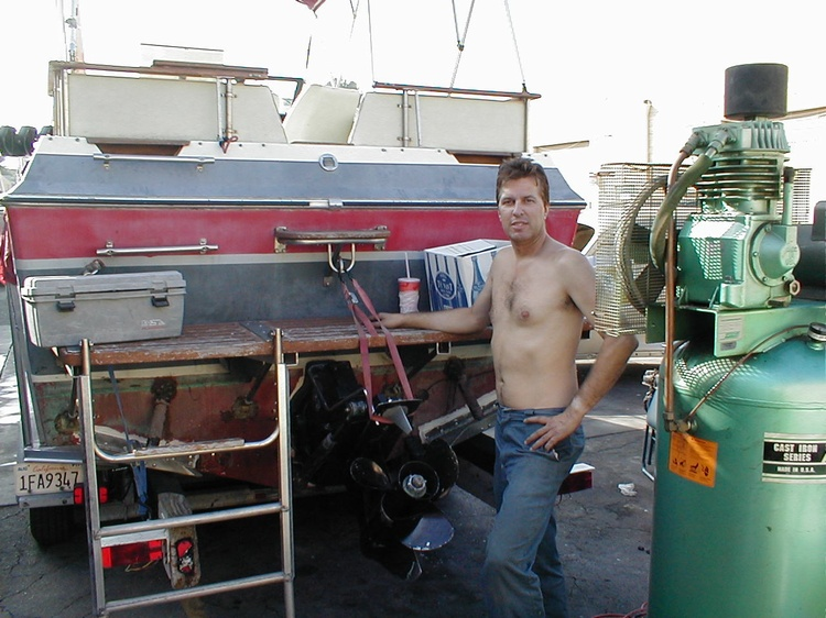 CALIFORNIAKEITH workin on the boat, notice the long ladder & a water sking ring.