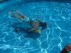 My daughter in pool with pony