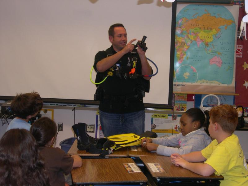 Invited to a school to teach students about scuba
