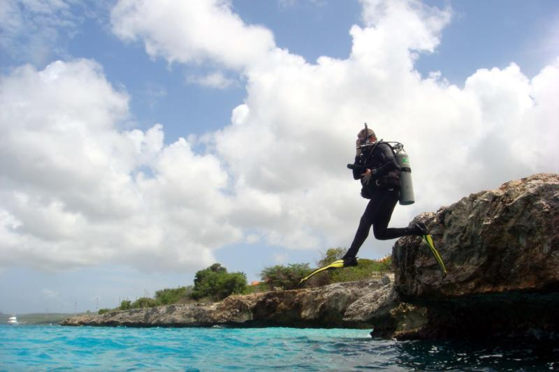 Me, jumping off of Oil Slick, bonaire